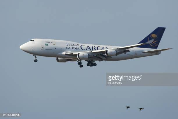 Saudi Arabian Airlines Boeing 747400F aircraft the nicknamed Queen of the Skies Jumbo Jet aircraft in a freight variant as seen on final approach...