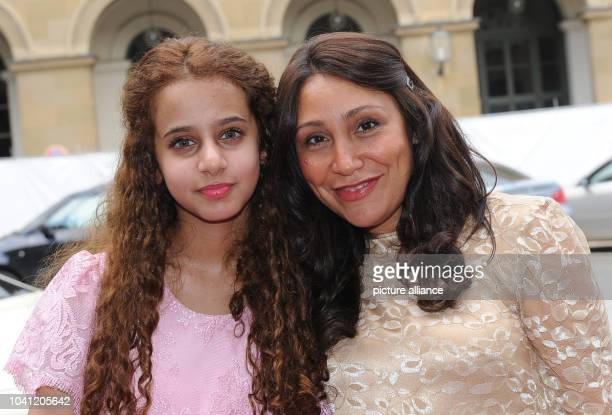 Saudi Arabian filmmaker Haifaa Al Mansour and actress Waad Mohammed arrive for the ceremony of the 'Bernhard Wicki Film Prize The Bridge German...