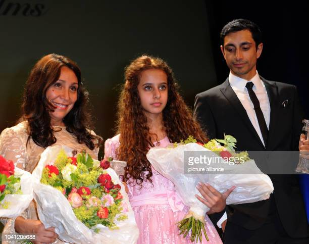 Saudi Arabian filmmaker Haifaa Al Mansour her young actress Waad Mohammed and British actor Riz Ahmed celebrate after the awarding of the German...
