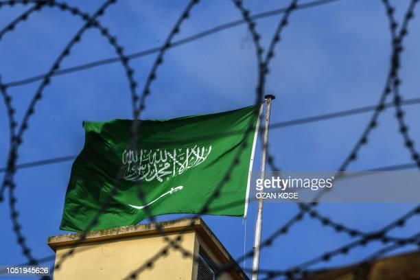 A Saudi Arabian flag flies behind barbed wires at the Saudi Arabian consulate in Istanbul on October 12 2018 Saudi Arabia's ambassador to Britain...