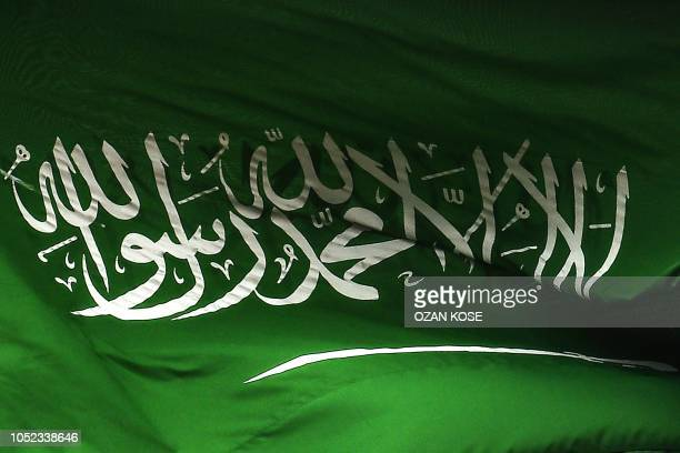 A Saudi Arabian flag flies over the consulate building in Istanbul on October 17 2018 Saudi Arabia's consul to Istanbul Mohammed alOtaibion on...