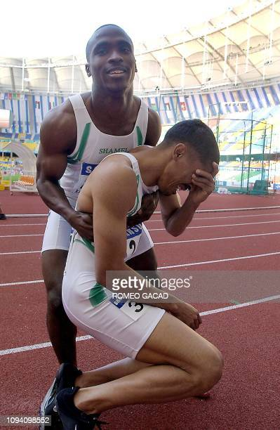 Saudi Arabian Jamal Al Saffar is lifted by his compatriot Salem Al Yami after winning the men's 100m final during the 14th Asian Games in Busan 08...