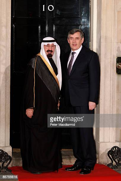 Saudi Arabian King Abdullah bin Abdul Aziz Al Saud is greeted by British Prime Minister Gordon Brown as he arrives at Downing Street for dinner on...