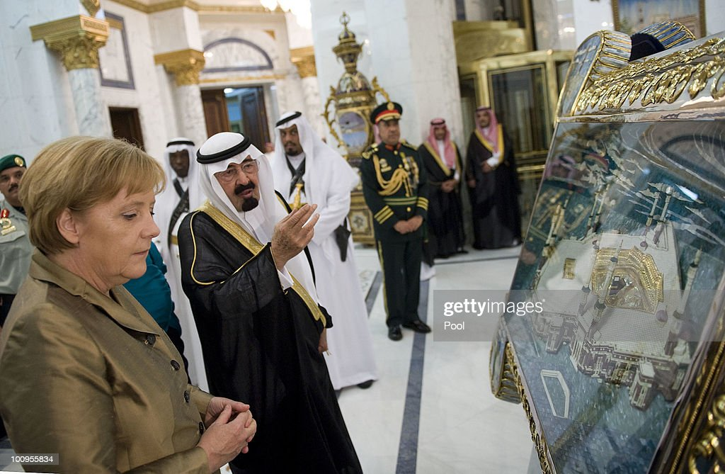 Saudi Arabian King Abdullah Bin-Abd-al-Aziz Al Saud explains a painting of Mecca to German Chancellor Angela Merkel in the King's Palace on May 25, 2010 in Djidda, Saudi Arabia. Merkel began her four-day tour of the Gulf region in the United Arab Emirates on May 24 to promote the Middle East peace process. Political talks in the United Arab Emirates, Bahrain, Qatar and Saudi Arabia will also be dominated by regional security issues and the nuclear standoff with Iran.
