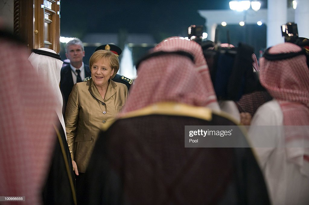 Saudi Arabian King Abdullah Bin-Abd-al-Aziz Al Saud (L) welcomes German Chancellor Angela Merkel in the King's Palace on May 25, 2010 in Djidda, Saudi Arabia. Merkel began her four-day tour of the Gulf region in the United Arab Emirates on May 24 to promote the Middle East peace process. Political talks in the United Arab Emirates, Bahrain, Qatar and Saudi Arabia will also be dominated by regional security issues and the nuclear standoff with Iran.