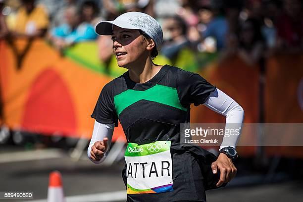 Saudi Arabian' marathon runner Sarah Attar rounds the women's marathon loop at Batafogo Beach in Rio de Janeiro Brazil during the 2016 Olympic Summer...