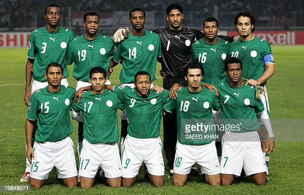 Saudi Arabian national football team members pose for group picture before the start of the final match of the Asian Football Cup 2007 between Iraq...