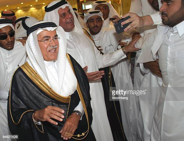 Saudi Arabian Oil Minister Ali alNaimi left with Qatari Oil Minister Abdullah bin Hamad alAttiyah second left meet the press in Doha Qatar Thursday...