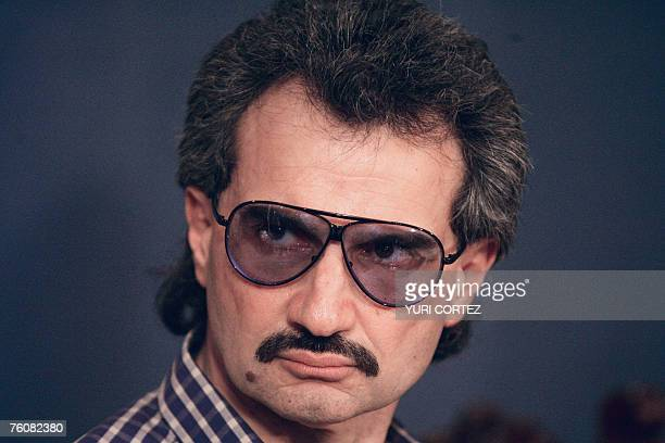 Saudi Arabian prince Alwaleed Bin Talal Alsaud listens to a question during a press conference after meeting with Costa Rican president Oscar Arias...