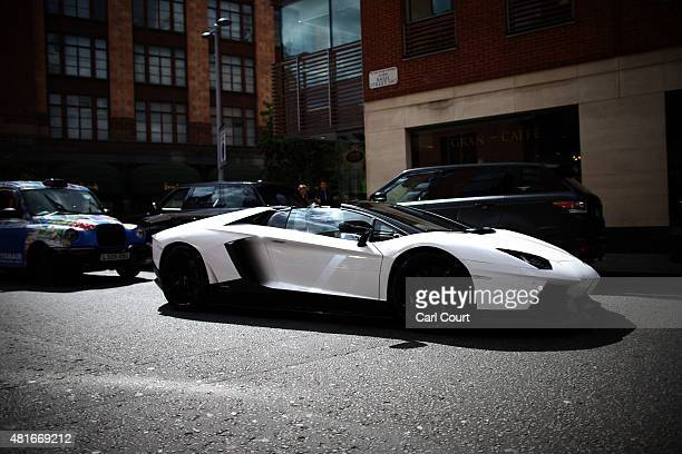 Saudi Arabian registered Lamborghini is driven through Knightsbridge on July 21 2015 in London England Knightsbridge has become known in recent years...