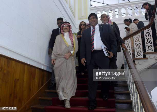Saudi Arabian royal AlWaleed Bin Talal bin Abdulaziz al Saud and Sri Lankan Foreign Minister Ravi Karunanayake leave after a meeting in Colombo on...