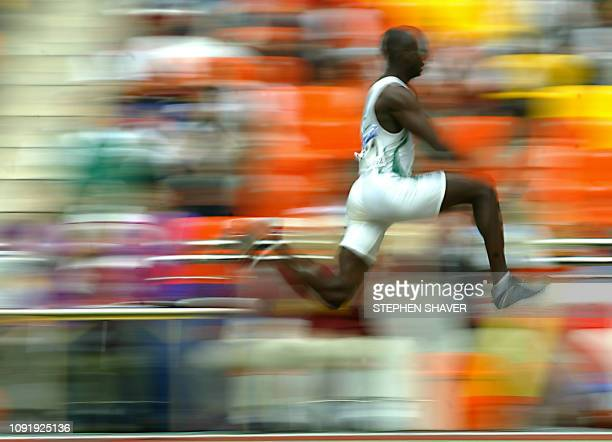 Saudi Arabian Salem Al Mowallad in action during the men's triple jump final at the 14th Asian Games in Busan 09 October 2002 Al Mowallad won the...