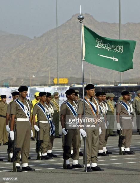 Saudi Arabian security forces soldiers stand in ranks and carry a Saudi flag during a parade on January 4 2006 in the city of Mecca Saudi Arabia...