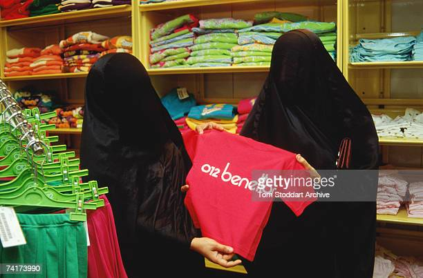Saudi Arabian women shopping in United Colours of Benetton in Dhahran wearing the traditional Muslim burqa December 1990