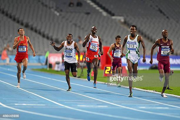 Saudi Arabia's Abdulaziz Mohammed , Musaab Bala of Qatar and Abraham Kipchirchir Rotich of Bahrain who took 1st, 2nd and 3rd place in the men's 800 m...