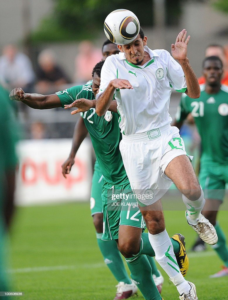 Saudi Arabia's Abdullatif AlGhannam (front) heads a ball backed by Nigeria's Austin Ejide during their friendly match between Saudi Arabia and Nigeria in Alpen stadium in Tyrolian Wattens on May 25, 2010 prior to the FIFA World Cup 2010 hosted by South Africa.