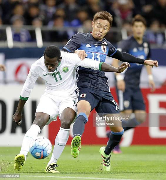 Saudi Arabia's Abdulmalek Al Khaibri and Hiroshi Kiyotake vie for the ball during the first half of an Asian World Cup qualifier at Saitama Stadium...
