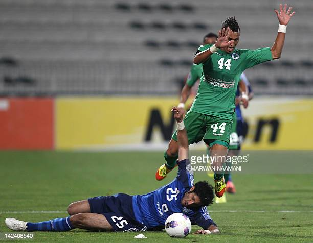 Saudi Arabia's alHilal club player Majed vies for the ball against Jociel Ferreira Da Silva of UAE's alShabab club during in the AFC Champions League...