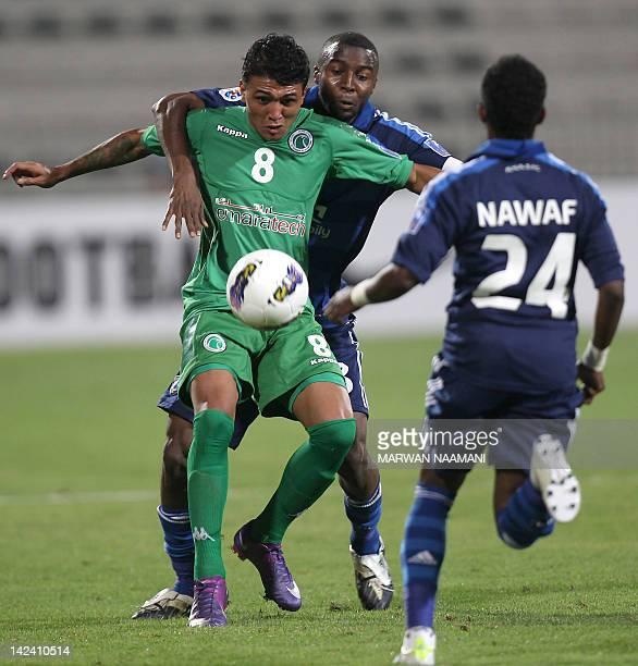 Saudi Arabia's al-Hilal club player Osama Hawsawi vies for the ball against Welker Marcal al-Meida of UAE's al-Shabab club as Nawaf Alabed of...