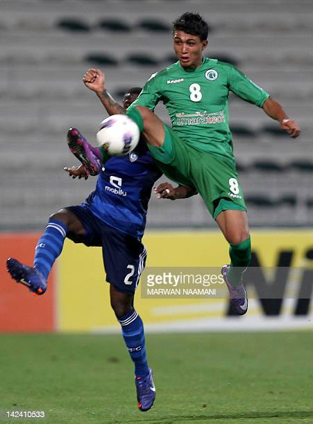 Saudi Arabia's alHilal club player Sultan alBeshi vies for the ball against Welker Marcal alMeida of UAE's alShabab club during in the AFC Champions...