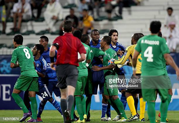 Saudi Arabia's alHilal club players clash with players from UAE's alShabab team during their AFC Champions League football match in Dubai on April 4...