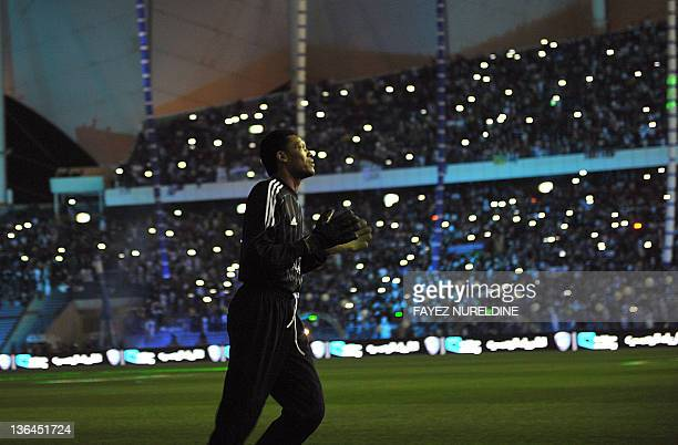 Saudi Arabia's alHilal legend goalkeeper Mohammed alDeayea farewells his fans during his farewell match at the King Fahad stadium in Riyadh on...