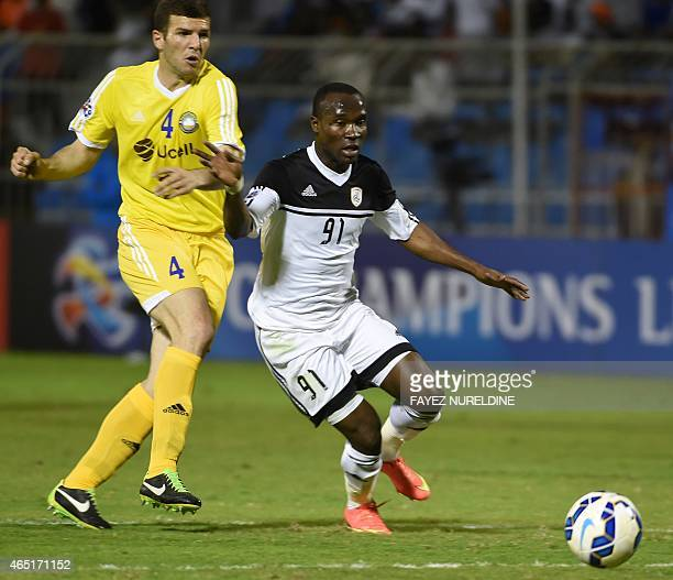Saudi Arabia's AlShabab player John Antwi fights for the ball against Uzbekistan's Pakhtakor player Adnan Orahovac during their AFC Champions League...