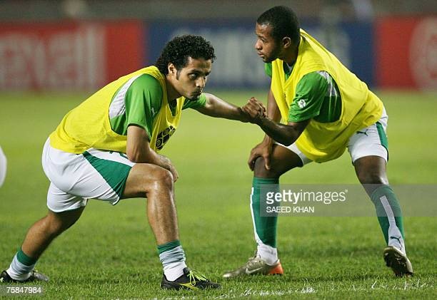 Saudi Arabia's captain Yasser Al Qahtani and teammate Malek Alhawsawi warm up before the start of the final match of the Asian Football Cup 2007...