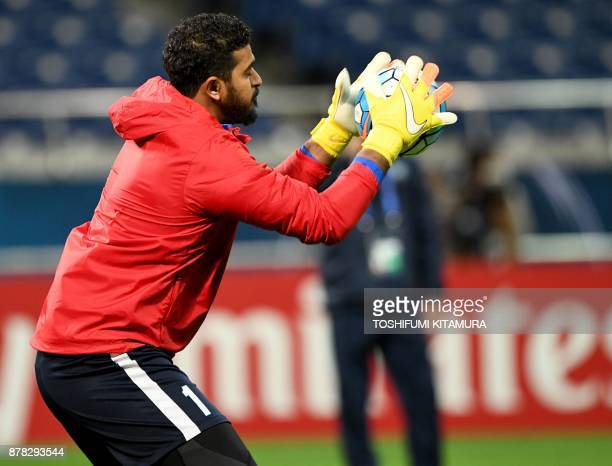 Saudi Arabia's club team AlHilal goalkeeper Abdullah Almuaiouf catches the ball during their official training session one day before the AFC...