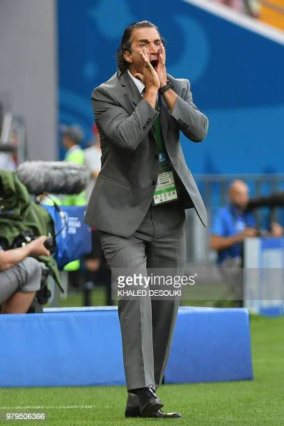 Saudi Arabia's coach Juan Antonio Pizzi shouts instructions from the sideline during the Russia 2018 World Cup Group A football match between Uruguay...