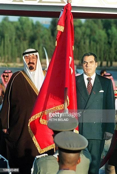 Saudi Arabia's Crown Prince Abdullah bin Abdel Aziz and Tunisian President Zine ElAbidine Ben Ali stand attention at national anthems 12 October 1999...