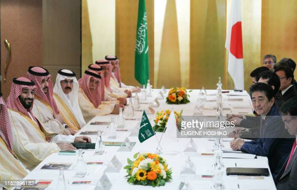 Saudi Arabia's Crown Prince Mohammed bin Salman and Japanese Prime Minister Shinzo Abe attend a meeting in Osaka on June 30 2019