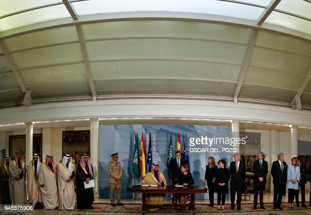 Saudi Arabia's crown prince Mohammed bin Salman and Spanish Minister of Defence Maria Doroles de Cospedal sign agreement at La Moncloa palace in...