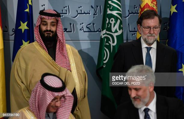 Saudi Arabia's crown prince Mohammed bin Salman and Spanish prime minister Mariano Rajoy look on during a signing ceremony at La Moncloa palace in...
