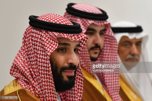 Saudi Arabia's Crown Prince Mohammed bin Salman attends a meeting with Russia's President Vladimir Putin on the sidelines of the G20 Summit in Osaka...