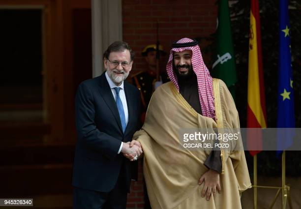 Saudi Arabia's crown prince Mohammed bin Salman is welcomed by Spanish prime minister Mariano Rajoy at La Moncloa palace in Madrid on April 12, 2018....