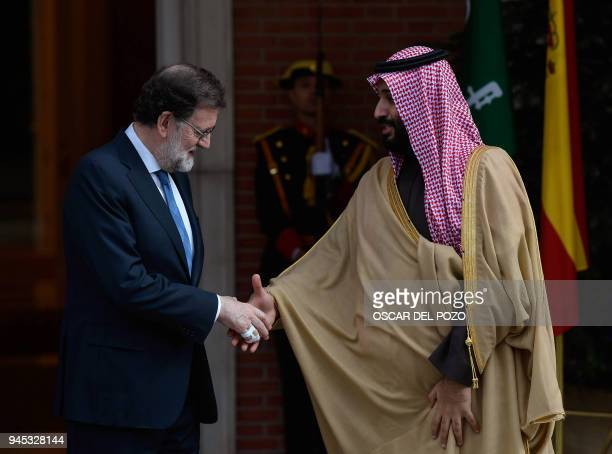 Saudi Arabia's crown prince Mohammed bin Salman is welcomed by Spanish prime minister Mariano Rajoy at La Moncloa palace in Madrid on April 12 2018...
