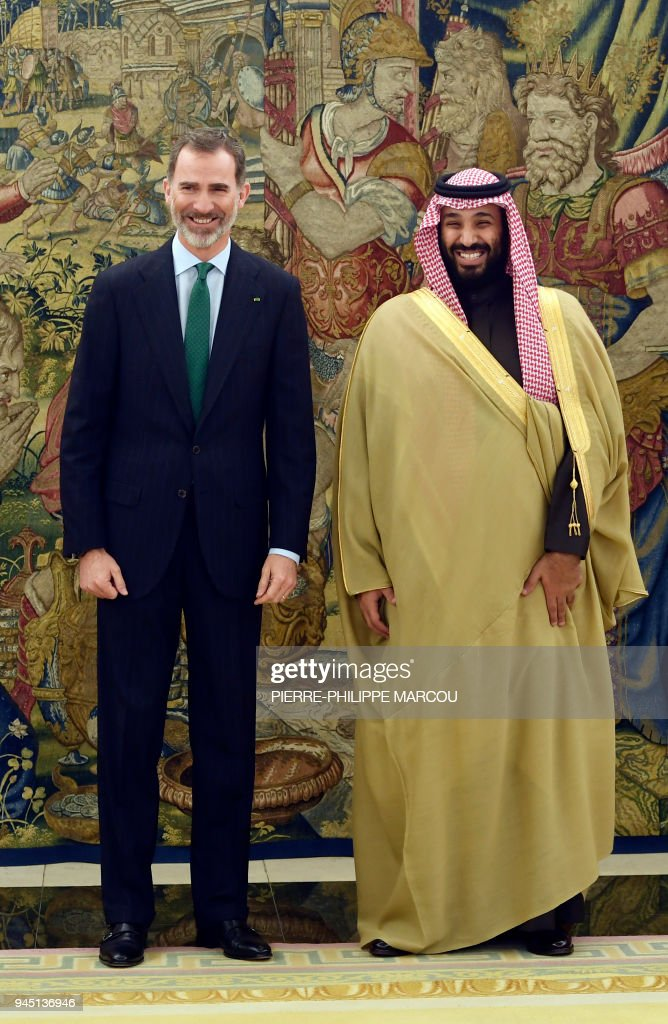 Saudi Arabia's crown prince Mohammed bin Salman (R) smiles as he poses with Spain's king Felipe VI at La Zarzuela palace in Madrid on April 12, 2018. Saudi Arabia's crown prince arrived in Madrid yesterday on the last stop of his global diplomatic charm offensive in a bid to project a new liberal image of his conservative kingdom. During his short visit Spain and Saudi Arabia are expected to sign five memorandums of understanding in the areas of culture, science, employment, air transport and defence, a Spanish foreign ministry source said. MARCOU