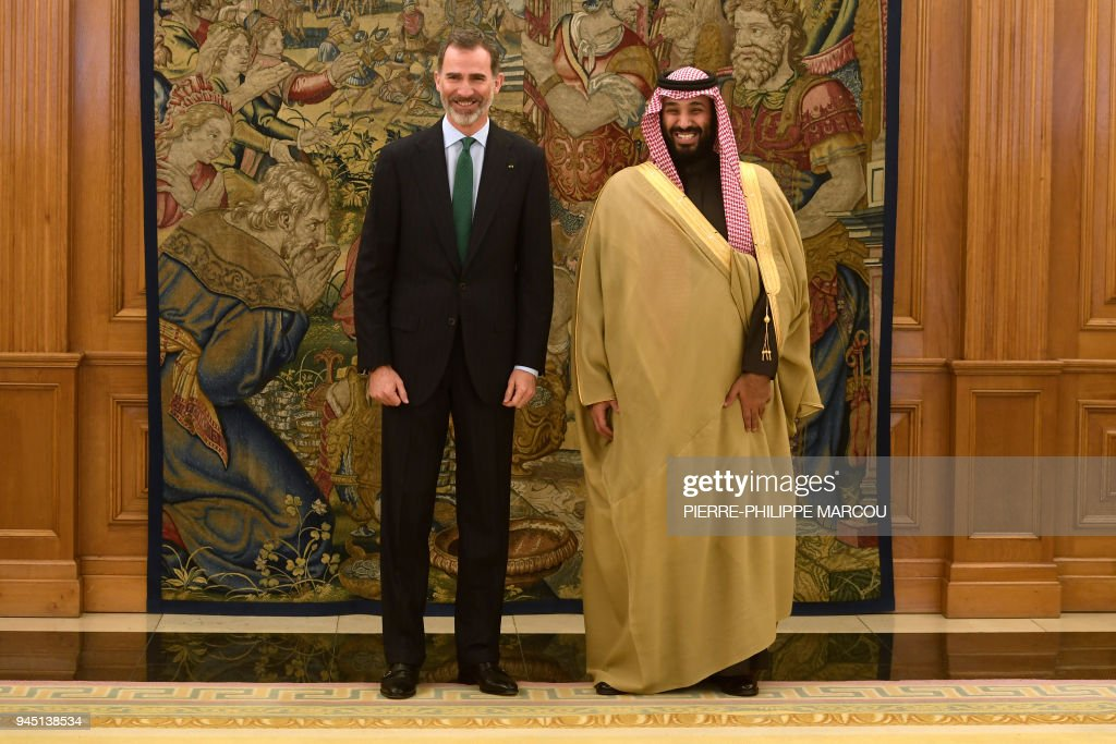 TOPSHOT - Saudi Arabia's crown prince Mohammed bin Salman (R) smiles as he poses with Spain's king Felipe VI at La Zarzuela palace in Madrid on April 12, 2018. Saudi Arabia's crown prince arrived in Madrid yesterday on the last stop of his global diplomatic charm offensive in a bid to project a new liberal image of his conservative kingdom. During his short visit Spain and Saudi Arabia are expected to sign five memorandums of understanding in the areas of culture, science, employment, air transport and defence, a Spanish foreign ministry source said. MARCOU