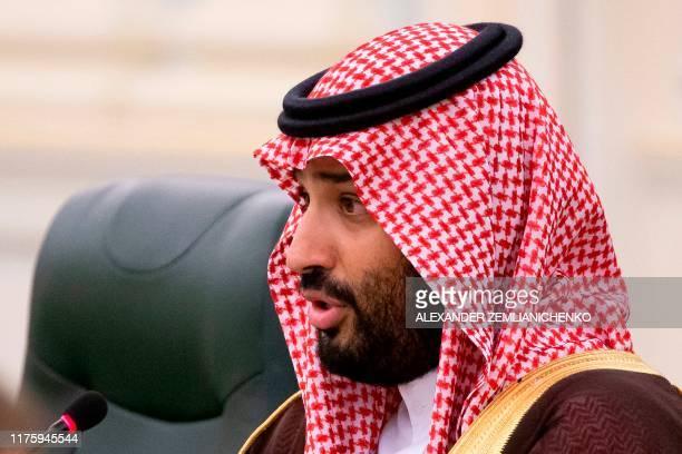 Saudi Arabia's Crown Prince Mohammed bin Salman speaks to Russian President during the talks in Riyadh, Saudi Arabia, on October 14, 2019.