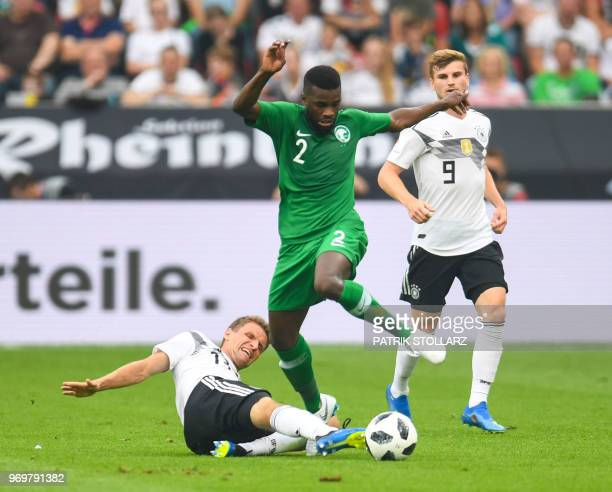 Saudi Arabia's defender Mansoor AlHarbi vies for the ball with Germany's forward Thomas Mueller and Germany's striker Timo Werner during the...