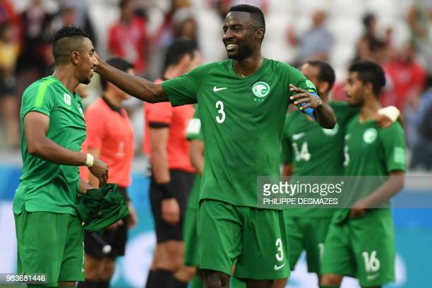 Saudi Arabia's defender Osama Hawsawi celebrates with forward Salem AlDawsari after they won the Russia 2018 World Cup Group A football match between...