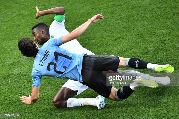 TOPSHOT Saudi Arabia's defender Osama Hawsawi fights for the ball with Uruguay's forward Edinson Cavani during the Russia 2018 World Cup Group A...