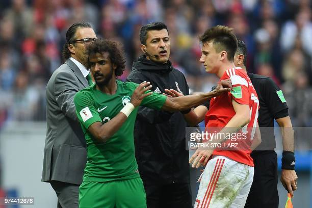 Saudi Arabia's defender Yasser AlShahrani argues with Russia's midfielder Aleksandr Golovin during the Russia 2018 World Cup Group A football match...