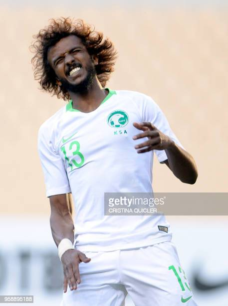 Saudi Arabia's defender Yasser AlShahrani gestures during the friendly football match between Saudi Arabia and Greece at the Olympic stadium in...