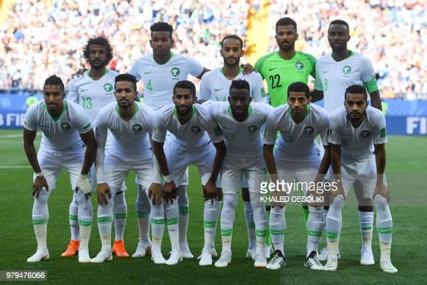 Saudi Arabia's defender Yasser AlShahrani Saudi Arabia's defender Ali AlBulaihi Saudi Arabia's midfielder Abdullah Otayf Saudi Arabia's goalkeeper...