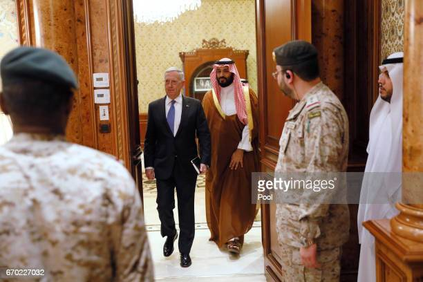 Saudi Arabia's Deputy Crown Prince and Defense Minister Mohammed bin Salman walks with US Defense Secretary James Mattis to the meeting with their...