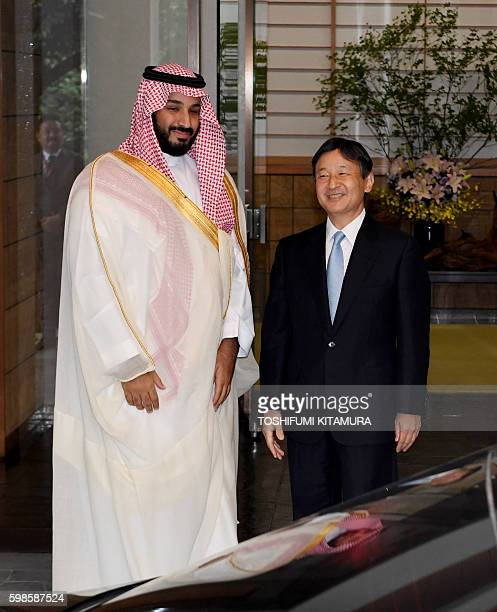 Saudi Arabia's Deputy Crown Prince Mohammad bin Salman poses with Japanese Crown Prince Naruhito at the entrance of the Togu Palace in Tokyo on...