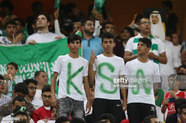 Saudi Arabia's fans cheer during the FIFA World Cup 2018 qualification football match between Saudi and Japan at King Abdullah bin Abdulaziz Stadium...