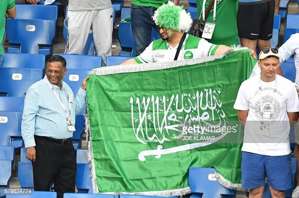 Saudi Arabia's fans holds a national flag in the stands at the end of the Russia 2018 World Cup Group A football match between Uruguay and Saudi...